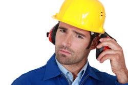 Man wearing safety earmuffs